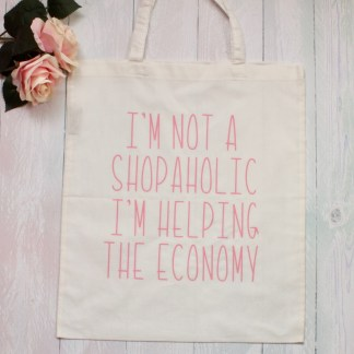 I'm not a shopaholic I'm helping the economy pink reusable tote bag