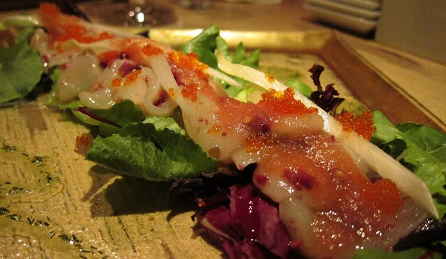 WHITE FISH CARPACCIO - served sashimi style with tobiko and endives served over fresh green