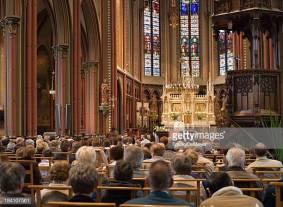 """Full church, with Roman Catholic service.Location: Belgium."""