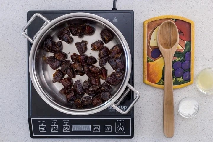 Medjool dates in a large sauce pan, about to be combined with lemon juice and cornstarch.