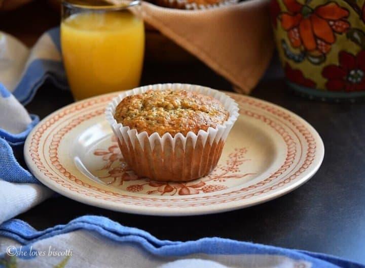 A single Lemon Poppy Seed Buttermilk Oatmeal Muffin on a plate.