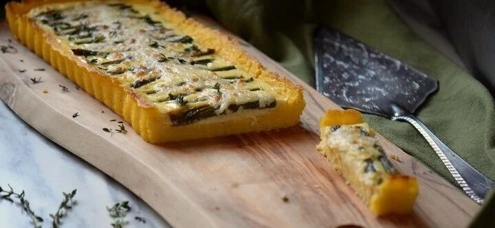 The Asparagus Ricotta Tart has been sliced to demonstrate the wonderful layers of ricotta, asparagus and melted mozzarella.