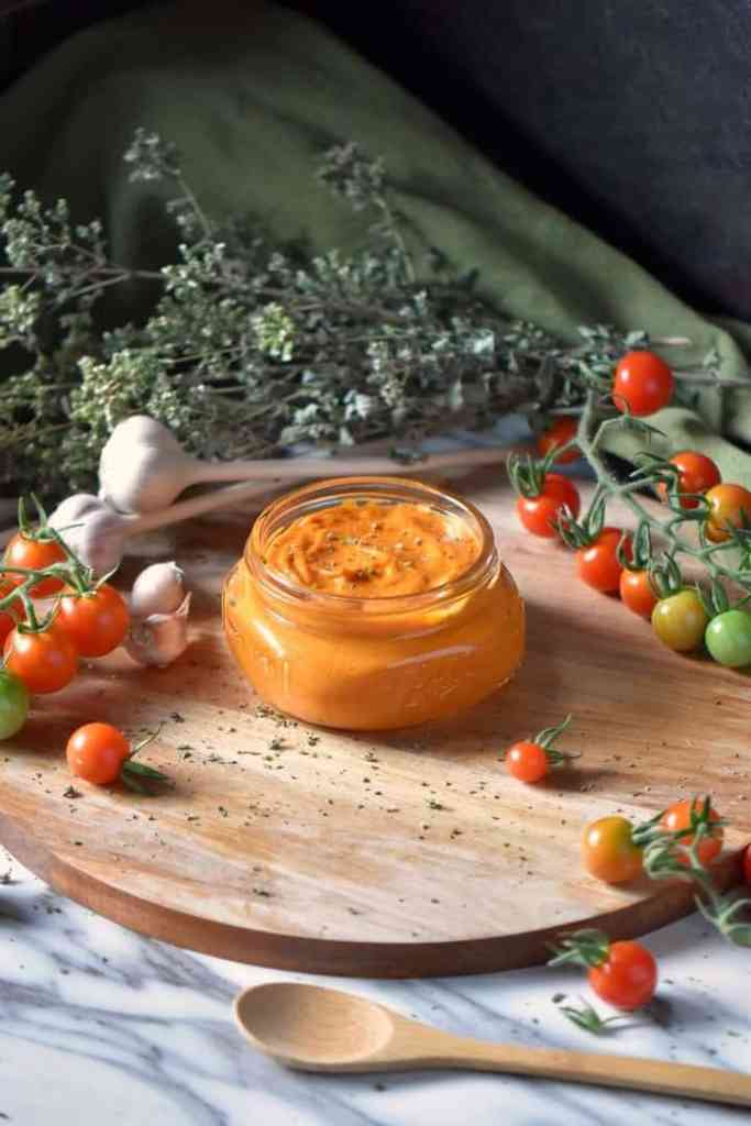 Roasted Cherry Tomato Sauce on a wooden round board.