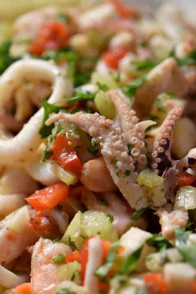 The beautiful bright colors of the seafood salad include carrots and red peppers.