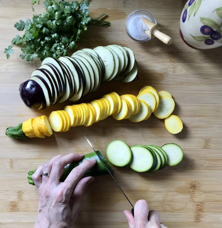 Sliced zucchini and eggplant on a wooden board soon to be transformed into the best grilled vegetables.