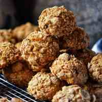 Crunchy oat bran cookies stacked on a cooling rack.