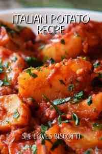 A baked potato casserole dish with tomato sauce.