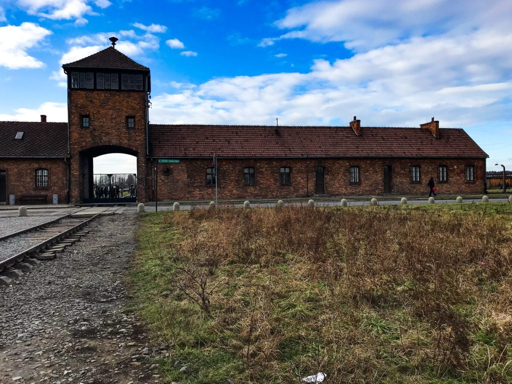 auschwitz-concentration-camp-main-building-blue-sky