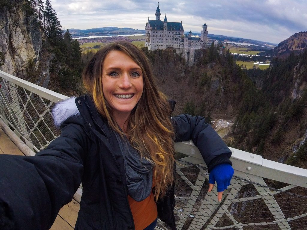 woman-taking-selfie-in-front-neuschwanstein-castle-germany