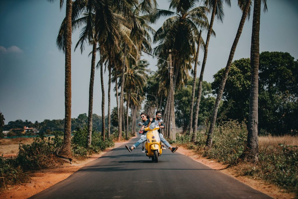 two people riding scooter travel blog potential
