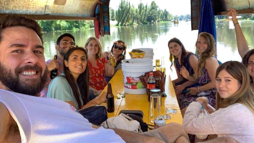 friends drinking on boat xochimilco river mexico city