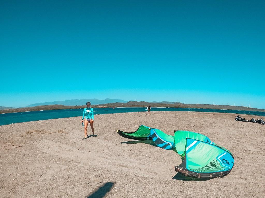 woman standing with kitesurfing kite in salinas de bani