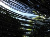 photo of sky through curved architectural elements on side of Sheps Center building