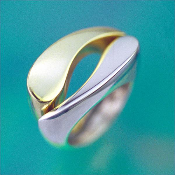 Pair of Yin Yan rings in white & yellow gold