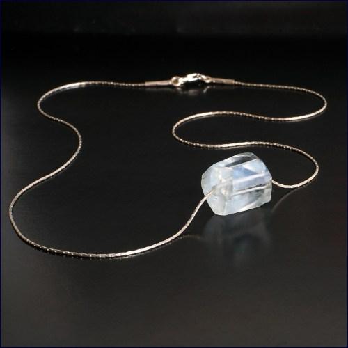 Aquamarine crystal on silver thread chain