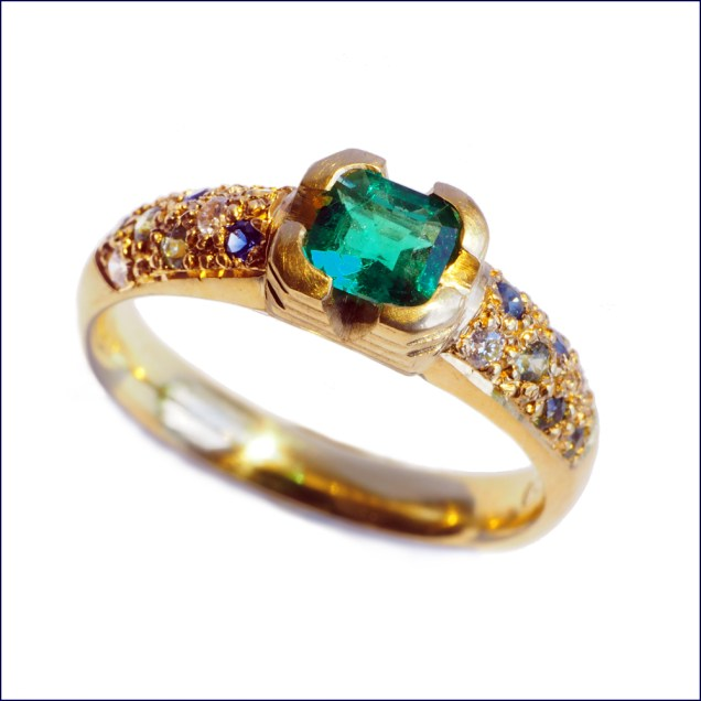 Allison's emerald, diamond and Australian sapphire engagement ring.