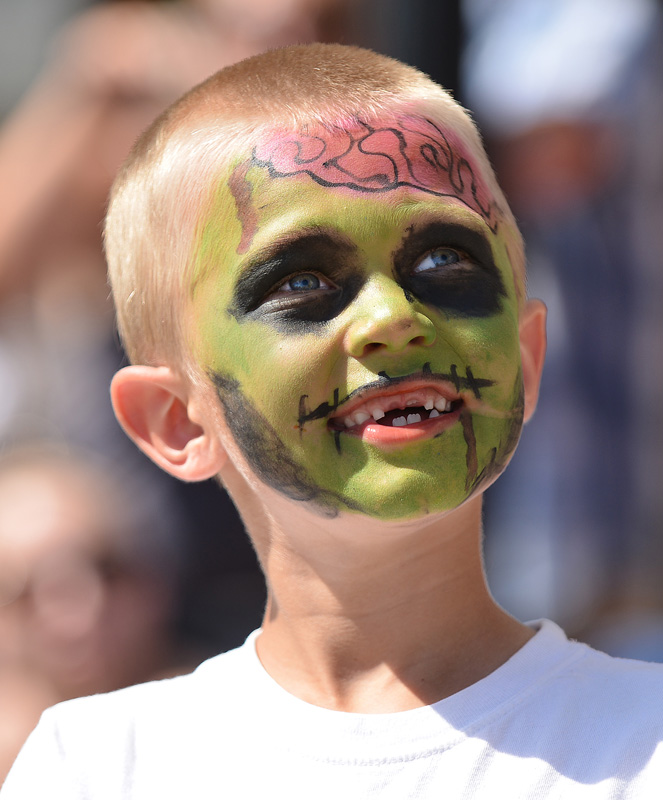 Six-year-old Cash Kula wears zombie face paint during the 2014 Sheridan WYO Rodeo Parade Friday morning on Main Street.