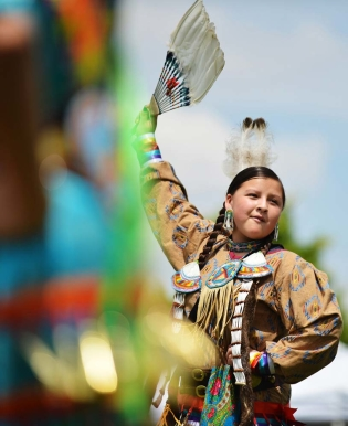 Fourteen-year-old McKenzie Archambeau of Lame Deer, Montana, dances during the powwow Friday afternoon at the historic Sheridan Inn.