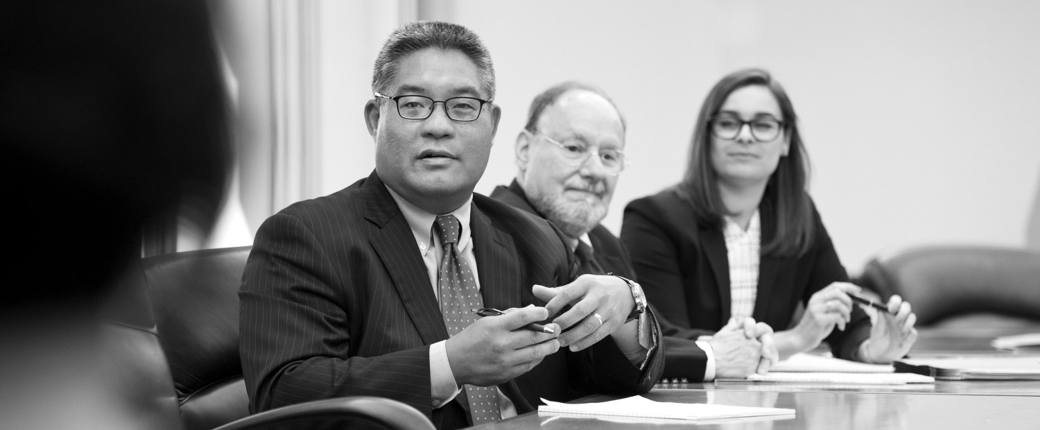 Edward Cheng sitting at conference table