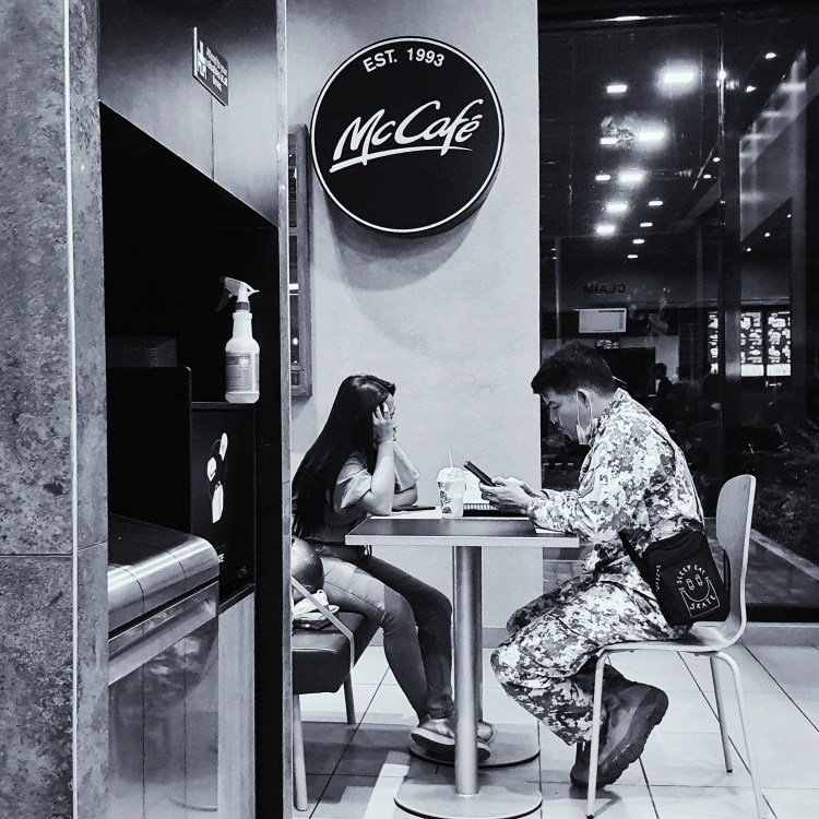 Street Photography in Manila, Philippines - Couple Eating at McDonalds