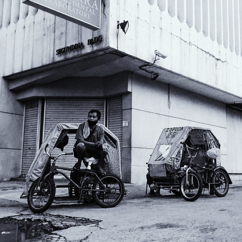 Street Photography in Manila, Philippines - Pedicabs Parked Waiting for Passengers