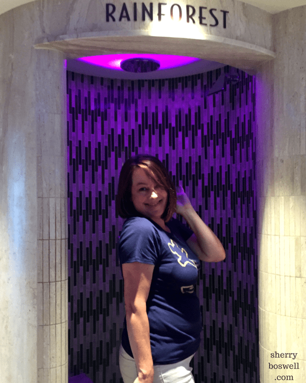 Disney Cruise Spa | Part of the Senses Spa, the Rain Forest is a must do on Disney Cruise Line. Goofing around at the rainforest shower that mists and changes colors.
