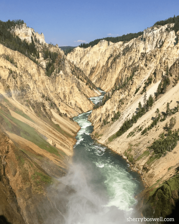 18 Travel Destinations in 2018 | Yellowstone National Park has scenery that will take your breath away, like the Lower Falls at the Grand Canyon.