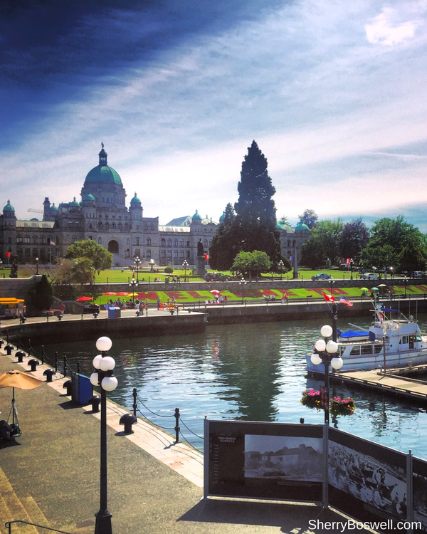 18 Travel Destinations in 2018 | Victorious in Victoria, British Columbia at the harbor in front of the Empress hotel and overlooking the Parliament building.