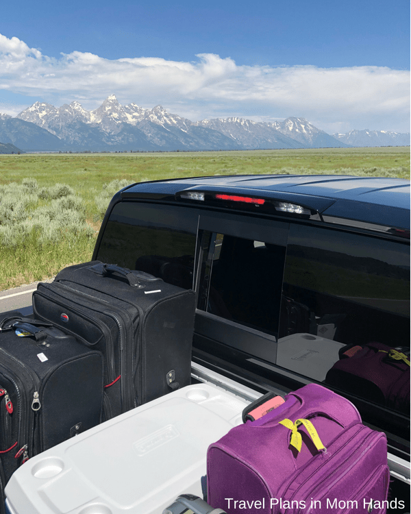 Our Nissan Titan meets the Grand Tetons-we are loaded down with our luggage in the flatbed, so we had plenty of space in the cab for our family of 4 on our Jackson Hole, Wyoming vacation.