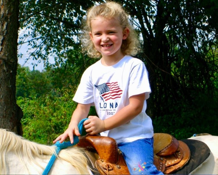 Getting nostalgic now that it's almost my daughter's 18th birthday, so I'm looking at all the old photos like my horse-loving daughter riding a horse when she was 2
