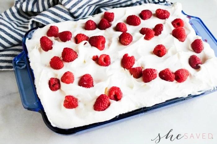 Raspberries on Poke Cake