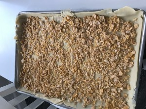 Add a layer of crushed frosted flakes--you can use cornflakes or unseasoned bread crumbs as well--but I like the frosted flakes. This will keep your bottom crust from being soggy.