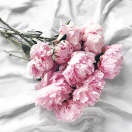 Because I'm an old soul, flowers are the way to my heart. My all-time favorite? Peonies.