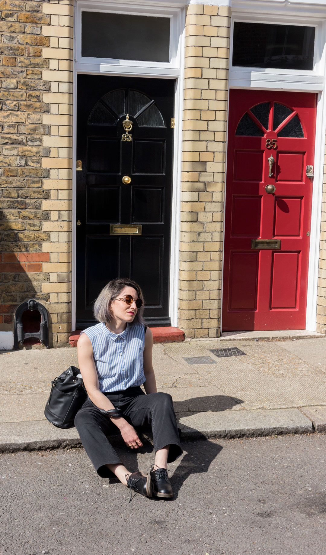 She talks Glam | Lawyer Striped sleeveless Shirt | High-rise Black Jeans | Basking in the sun | Shoreditch