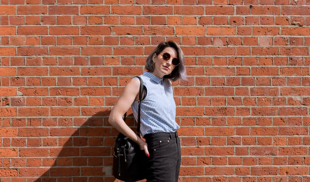 She talks Glam | Lawyer Striped sleeveless Shirt | High-rise Black Jeans | Shoreditch