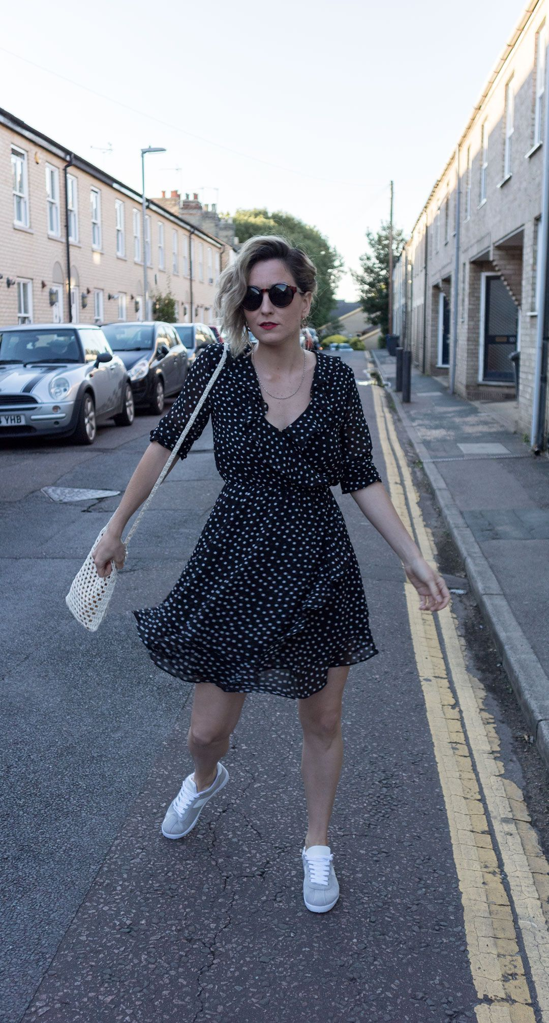 Romantic dress with a twist | Casual Tea Dress Styling | The polka dot dress you have seen all over Instagram this summer | Realisation par dupe | Polka dot wrap dress | Chiffon dress | Crochet bag | Chic outfit with a twist | Effortless chic | How to dress down a tea dress | Summer outfit inspiration | Cambridge Fashion | Saida Antolin | UK blogger | She talks Glam | The day that casual became chic | Wear it with sneakers | Easy summer outfit | Zara | H&M | ASOS | Black polka dot dress | Women with style | OOTD | Tomboy chic | Fall outfit | How to wear a tea dress | Gazelle sneakers | Adidas | Primark | Positive Fashion | From day to night outfit | Tortoiseshell sunglasses | How to dress up your sneakers