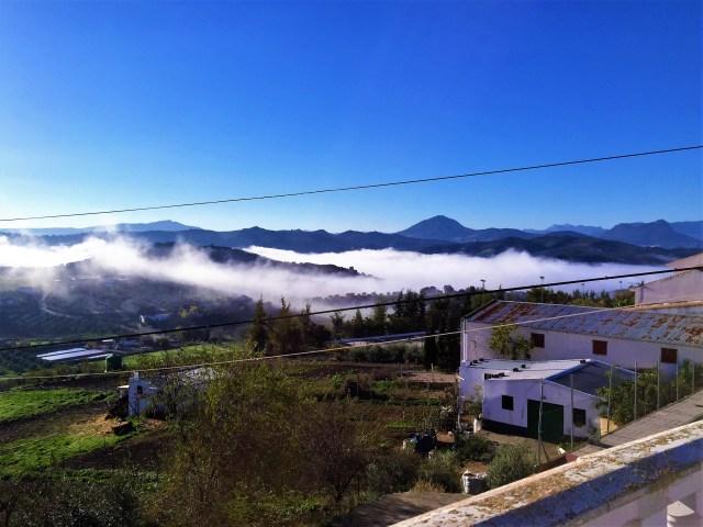 < Clouds under Olvera >