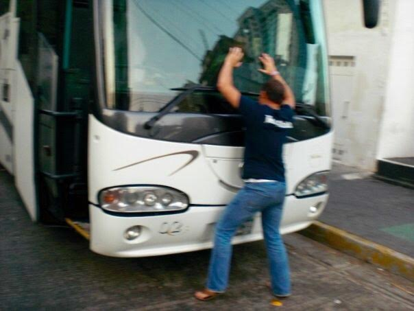< Buses in Acapulco >