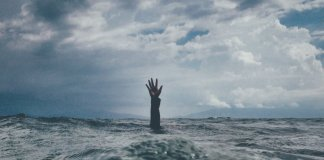 hand above water