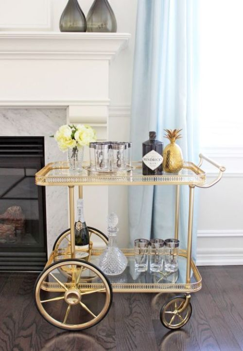 gallery-1443735690-vintage-maison-bagues-brass-bar-cart-styling7-1