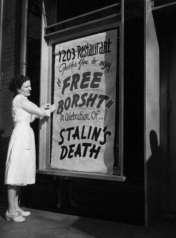 Woman Hangs Sign for Free Borsht