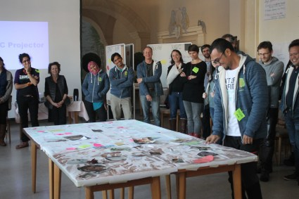 An international team share what motivates them and their wishes for the team's work on a giant tree mural.