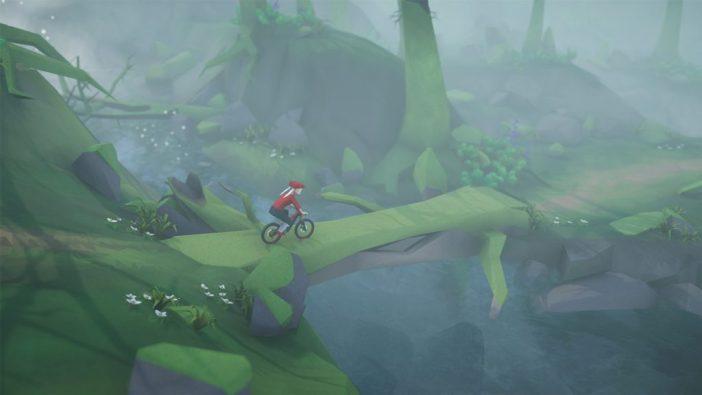 A screenshot from Lonely Mountains: Downhill showing a mountain biker using a fallen tree as a bridge across a river.