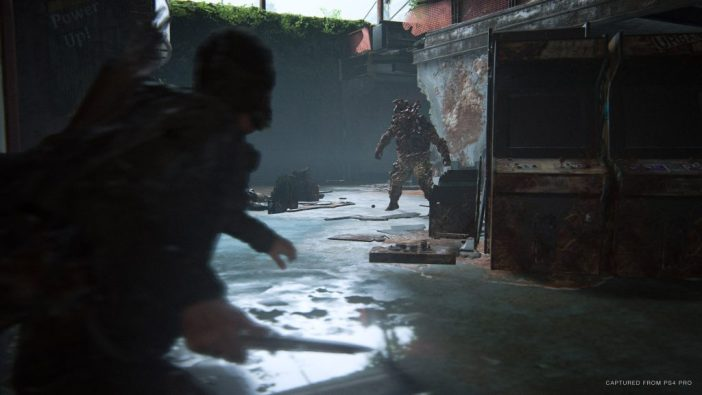 A screenshot from The Last of Us Part II showing Ellie fighting an infected.