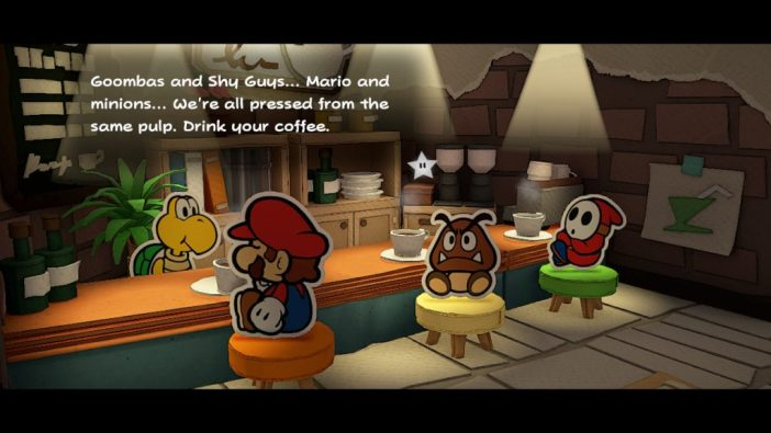 """A screenshot from Paper Mario: The Origami King, showing Mario, a Goomba, and a Shy Guy in a coffee bar. Text on screen reads, """"Goombas and Shy Guys... Mario and minions... We're all pressed from the same pulp. Drink your coffee."""""""