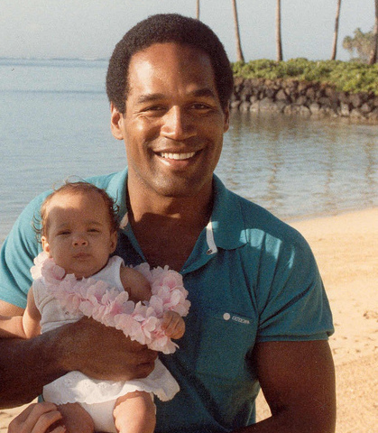 O J Simpson with his child [via Flickrcc]