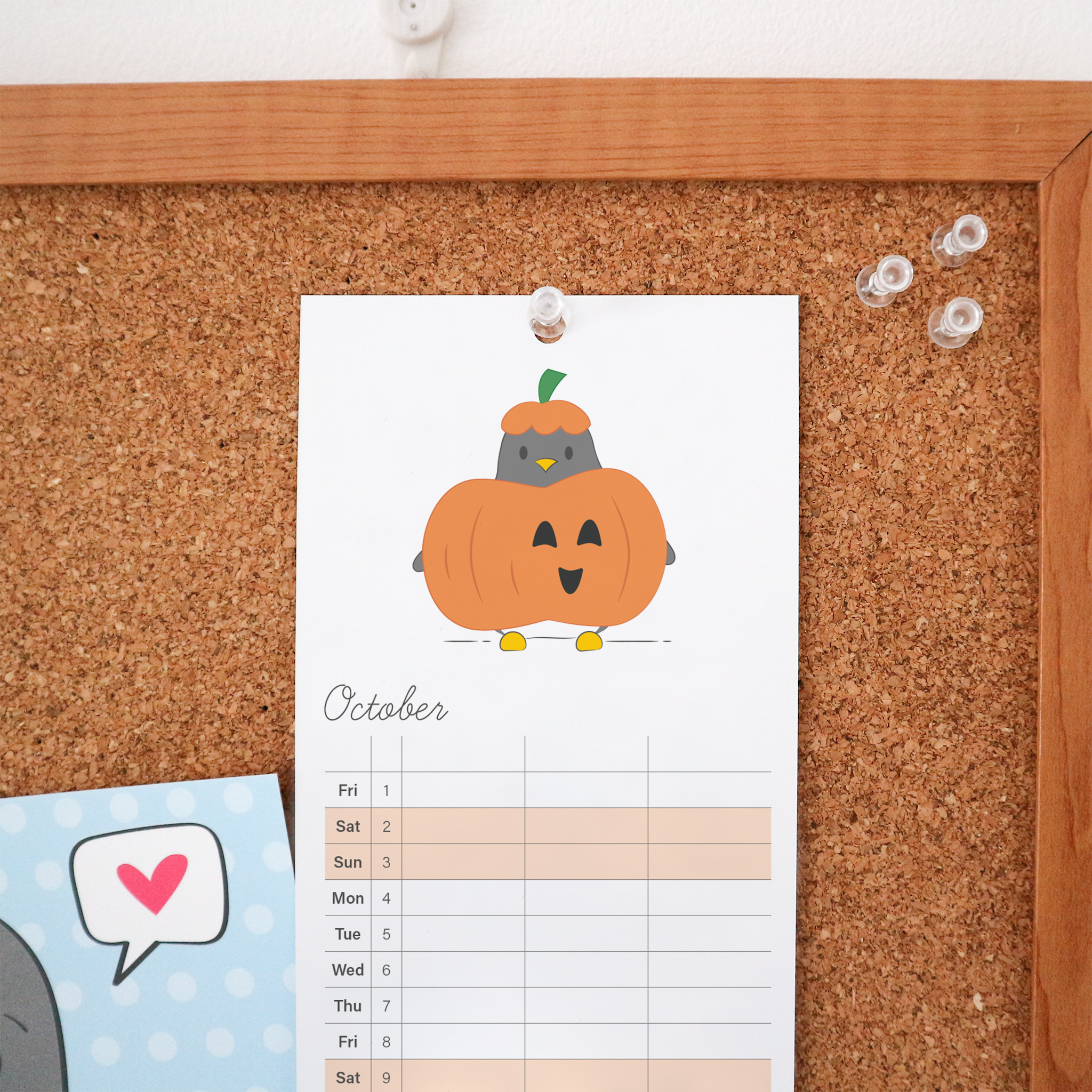 The October page of the calendar is an illustration of Penguin dressed as a pumpkin, he has a smiling orange pumpkin around his middle and is wearing an orange and green hat. This Calendar is a wire bound tall calendar and is styled against a cork board background.