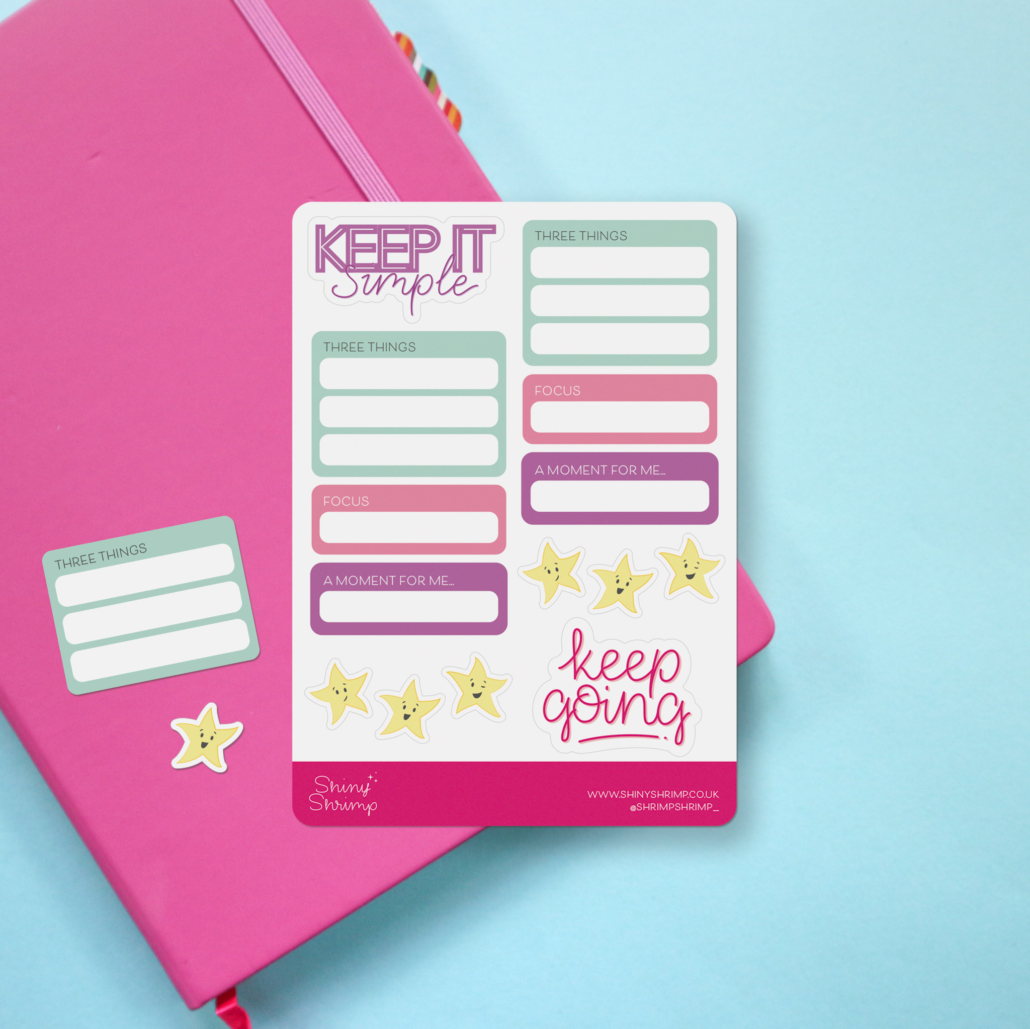 """Photo of a planner sticker sheet. To the top is a sticker saying """"Keep it simple"""" in a hand lettered style, and to the bottom right corner is a sticker saying """"keep going"""" also in a hand lettered style. Elsewhere on the sheet are stickers for your 3 to-do items for the day, a space for focus for the day and """"a moment for me."""" There are also 6 gold stars to celebrate your achievements."""