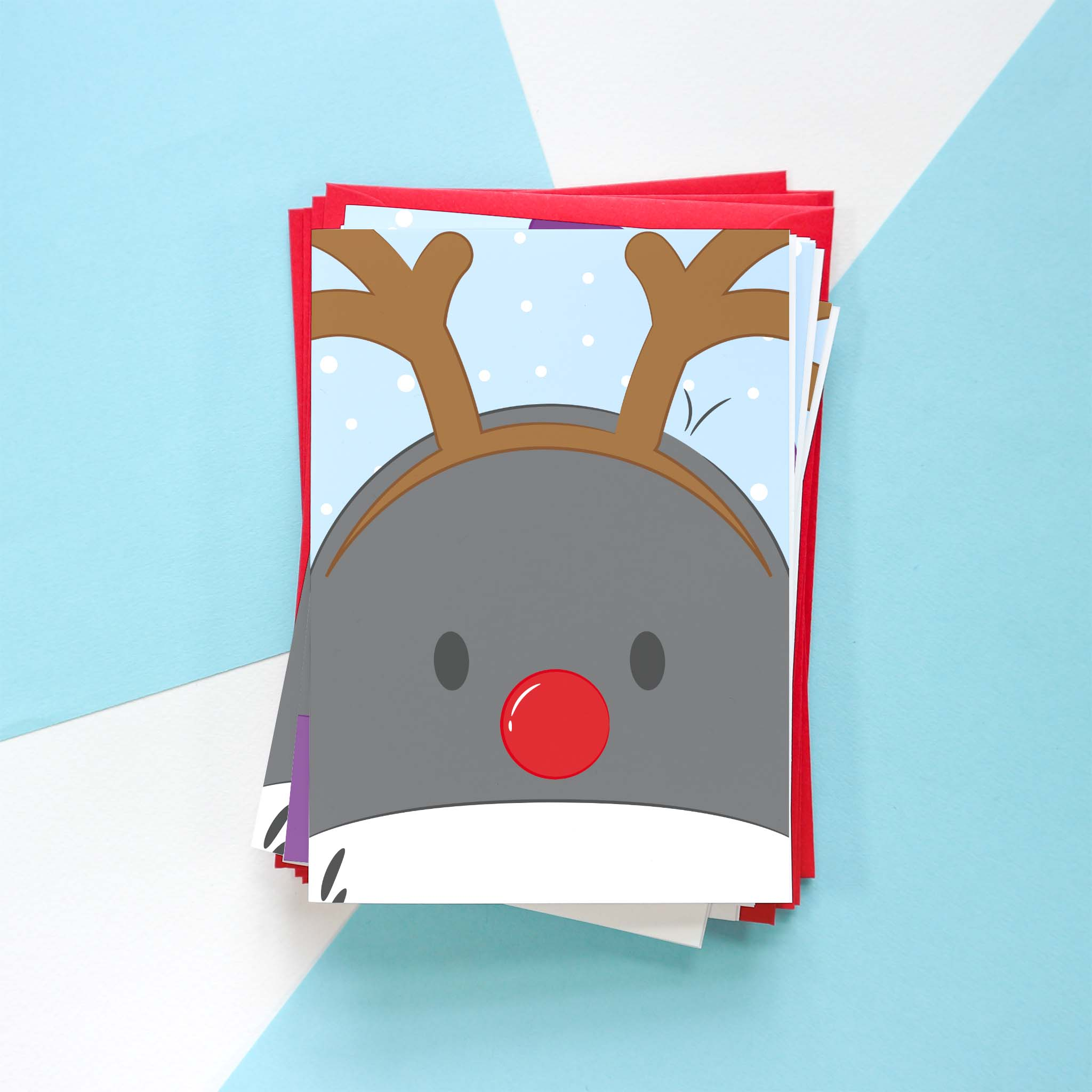 A photo of a Penguin Christmas card design. This design is of Penguin dressed as a reindeer.