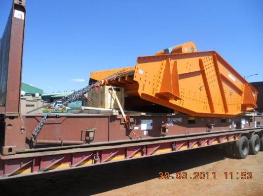 mining screen loaded on a flatrack container